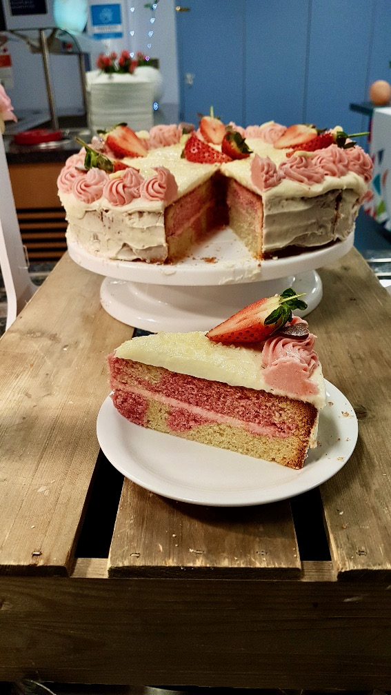 a plate of food that is on a cutting board with a cake