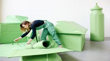 a woman tying her green artwork