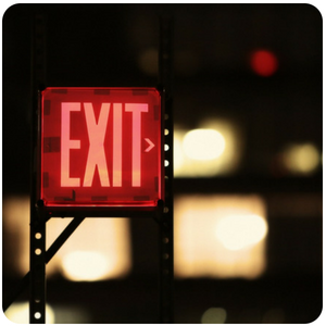 a close up of an exit sign