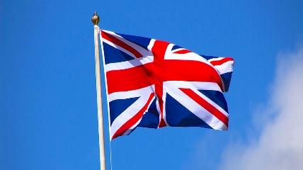 a flag flying on a clear blue sky