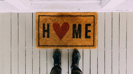 a door mat that says home on it
