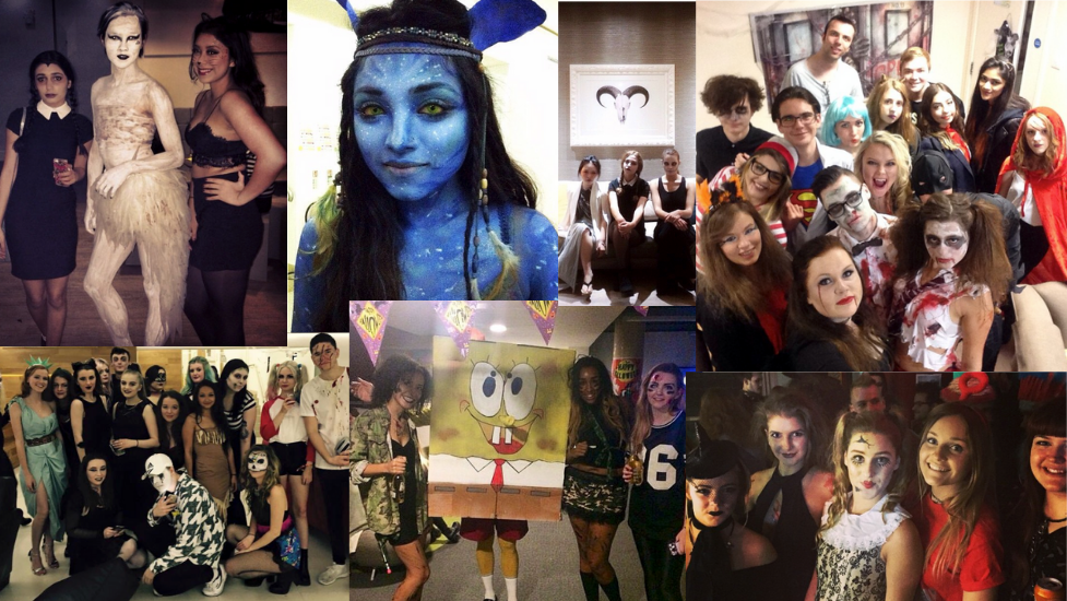 a group of ual students in halloween costumes  posing for a photo