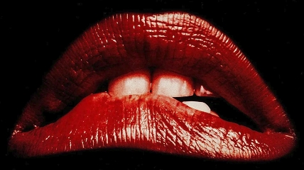 a close up of red lips biting it's lower lip