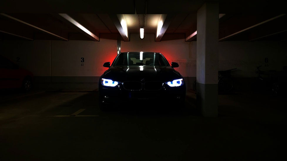 a car parked in a dark room
