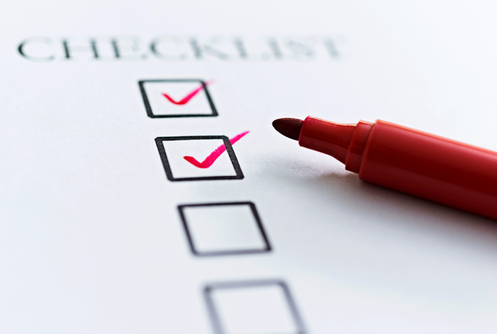 a checklist and a red pen