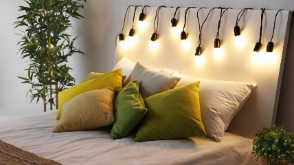 a bed with fairy lights on it