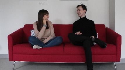 Will Keane et al. sitting on a sofa