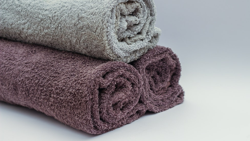 3 towels rolled up