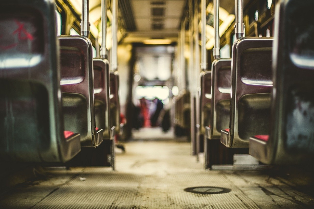 a passenger bus that is sitting on a subway car