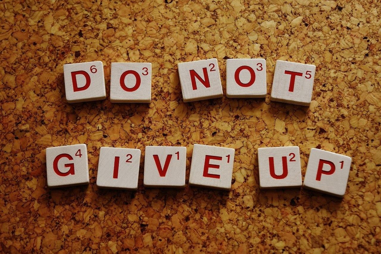 a close up of a motivational sign