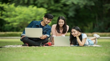 students studying outside on a sunny day