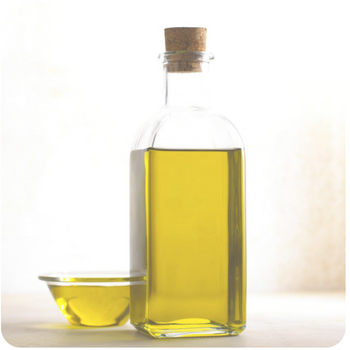 a close up of a bottle of olive oil