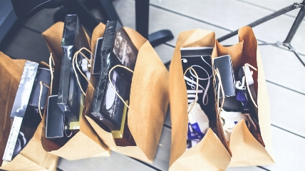 brown shopping bags with items in them