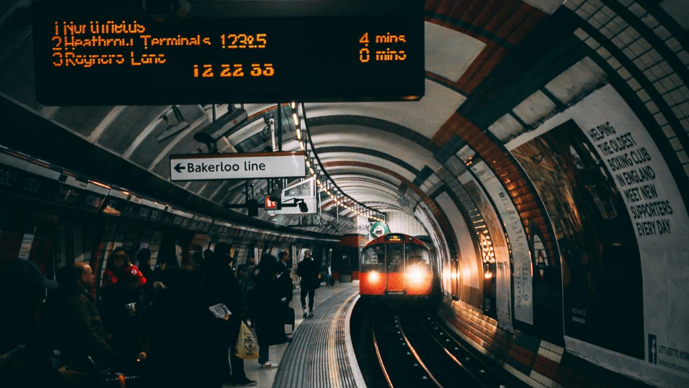 a train pulling into a tube station