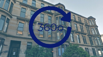 a 360 sign in front of a building