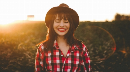 a person smiling wearing a hat