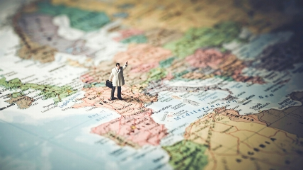 a small model figure standing on a map