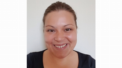 a woman smiling and posing for the camera