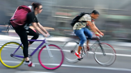 a person riding on the back of a bicycle