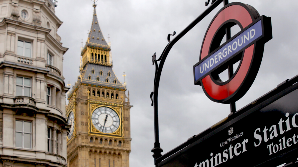an underground sign in London in front of Big Ben