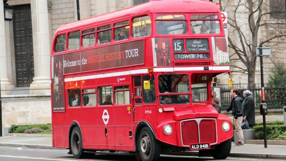 a double decker bus driving down a street