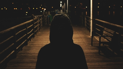 a person that is standing in the dark