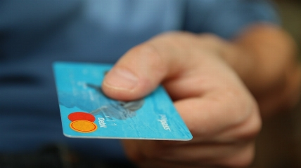 a close up of a hand holding a bank card