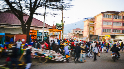 a group of people riding motorcycles on a city street