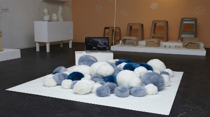 a group of stuffed animals sitting on top of a table