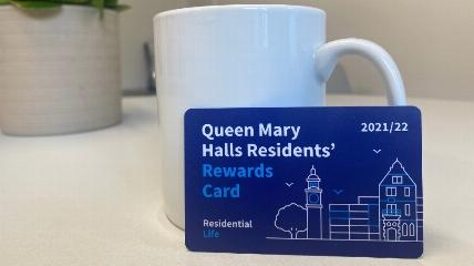 card next to a mug