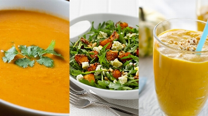 a bowl of soup and a glass of orange juice