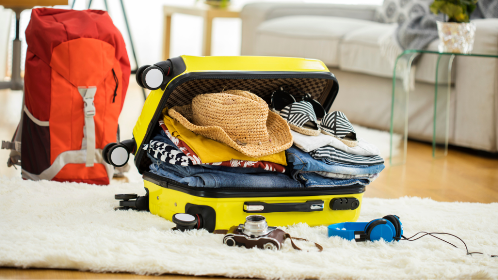 an open suitcase with clothes in