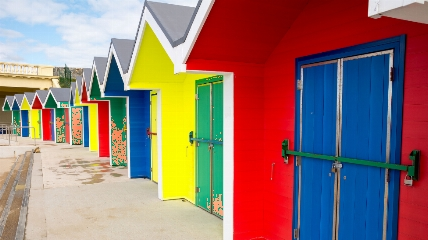 a close up of a blue doorBeach huts are Barry Island