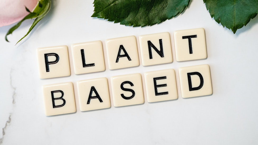 a close up of scrabble letters that says plant based