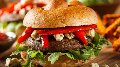 a close up of a mushroom burger