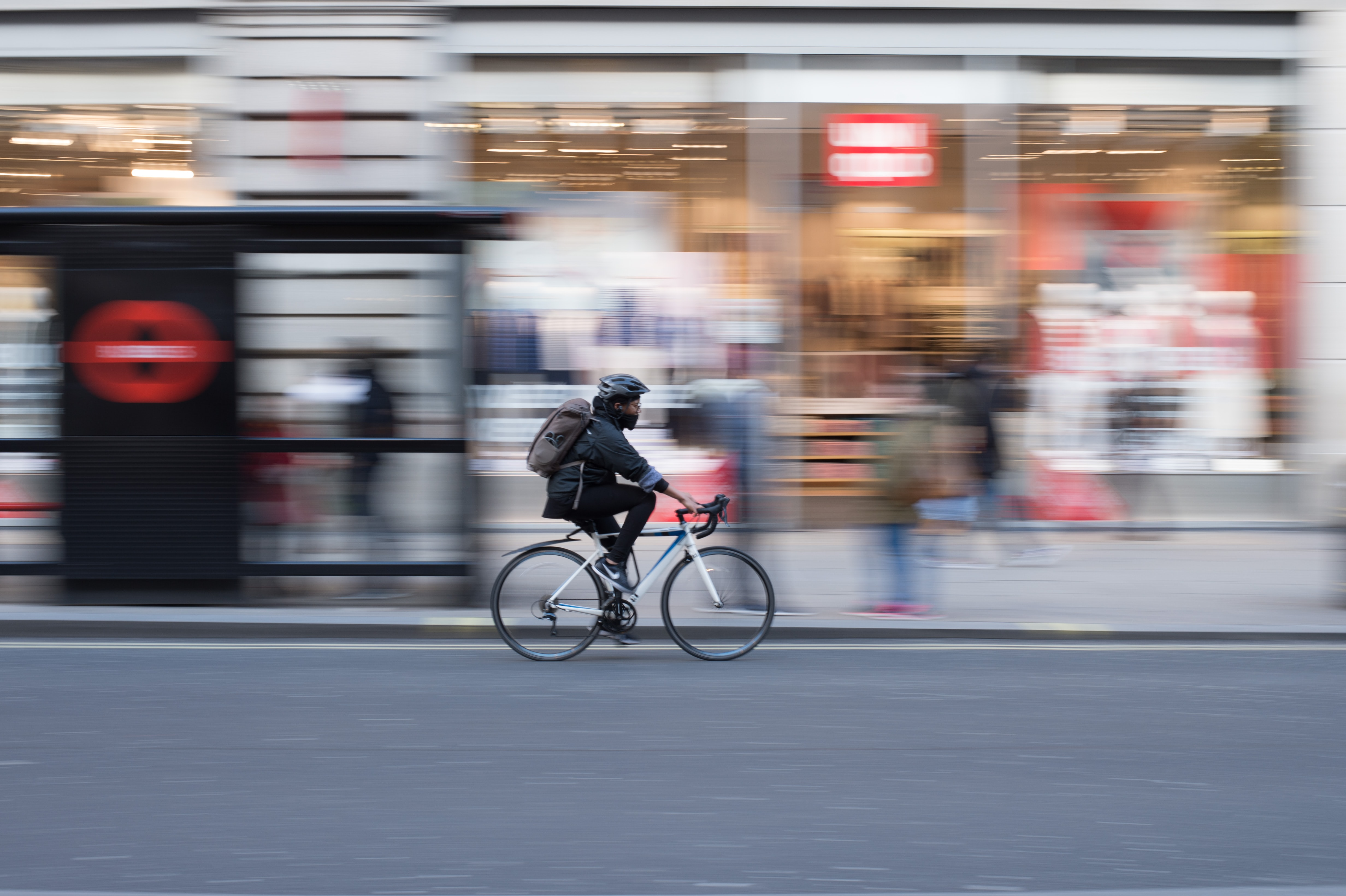 Person riding a bicycle on a city street