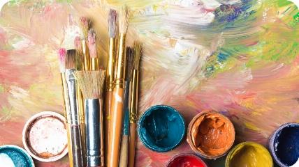 paint brushes next to paint pots