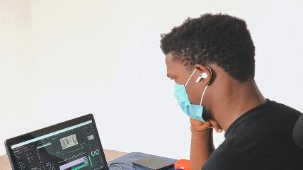 a man using a laptop computer