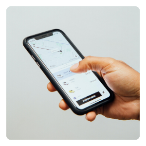 a hand holding a cellphone with the Uber app on it