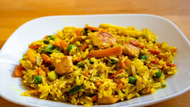 a plate of food with rice and vegetables