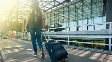 a person pulling a suitcase