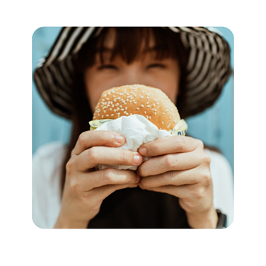 a person eating a donut