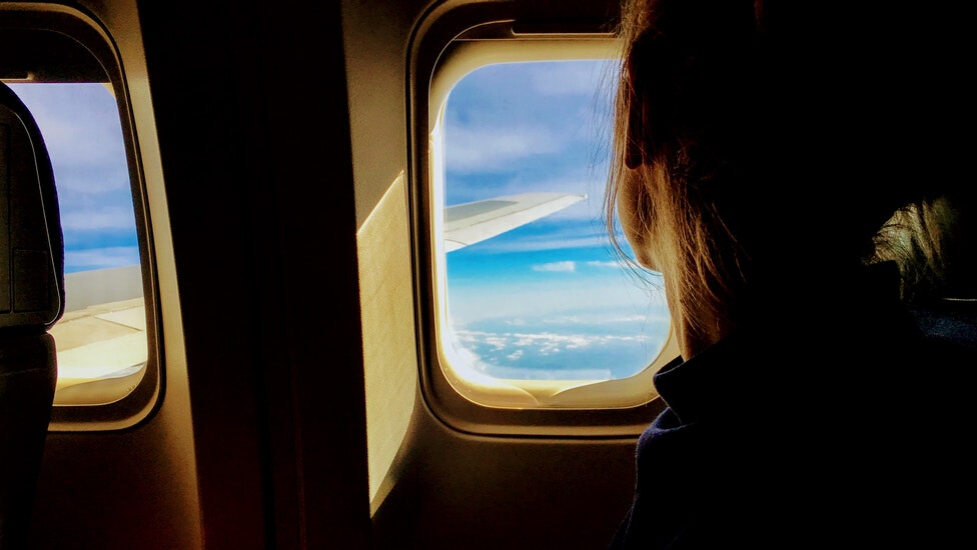 a passenger seat of a airplane window