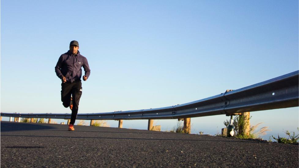 a man running along a road