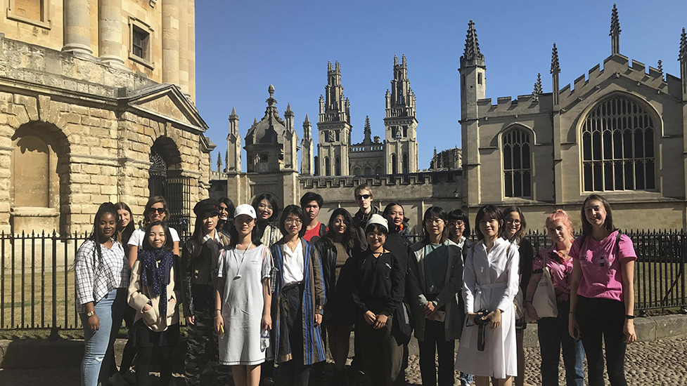 a group of UAL students posing for a photo in front of a cathedral in Oxford
