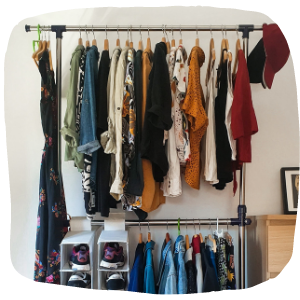 clothes hanging on a clothes rail