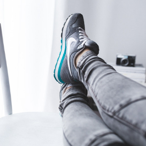 a person with their feet up on a sofa