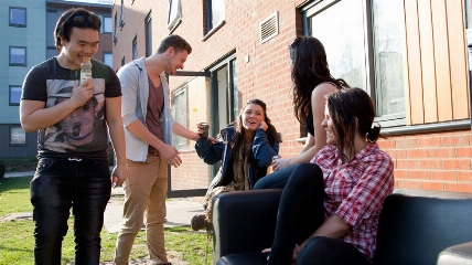 a group of people talking outside accommodation