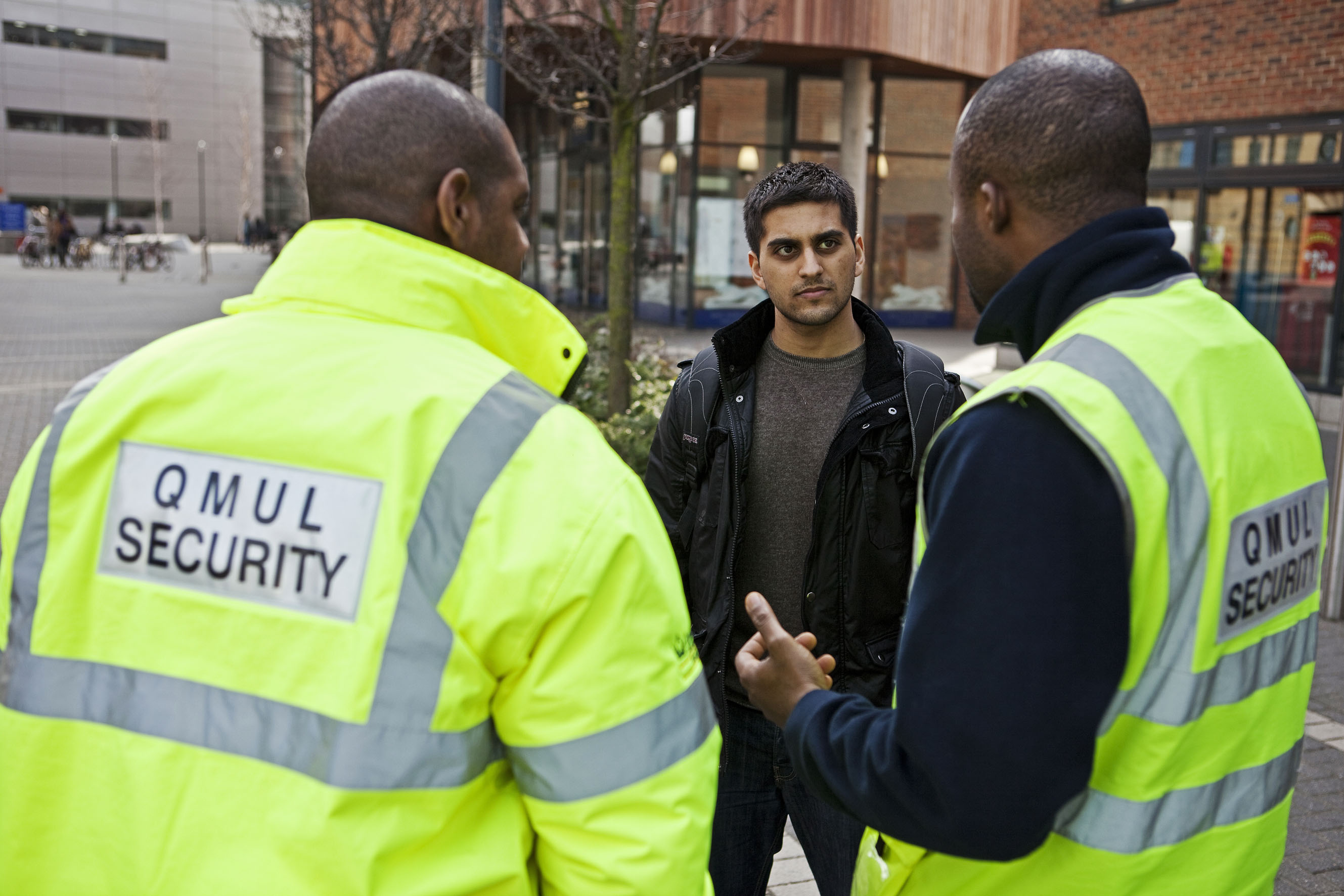 security team talking to a student