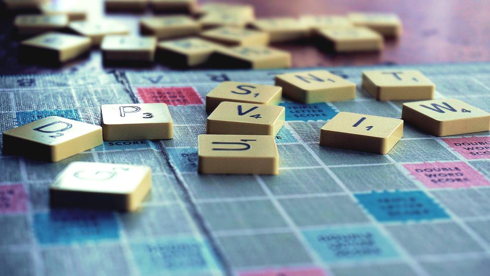 a close up of a scrabble board